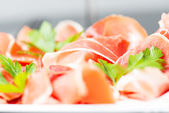 Cuted serrano ham with parsley — Stock Photo