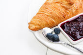 Croissant with blueberry jam high key — Stock Photo