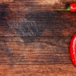Red peppers on wooden table copy space — Stock Photo