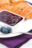 Croissant with blueberry in spoon — Stock Photo