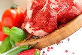 Organic Red Raw Steak on cutting board — Stock Photo