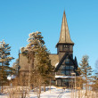 Old Holmenkollen chapel on sunny winter day Oslo Norway — Stock Photo #23130886