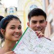 Young couple in town with touristic map — Stock Photo