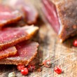 Stock Photo: Slices of cured meet and pepper on table