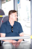 Man traveling on bus and looking through window — Stock Photo