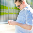 Portrait of middle-aged man with smartphone outdoors — Stock Photo
