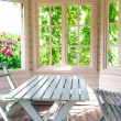 Summer house inside on sunny day — Stock Photo #27661801