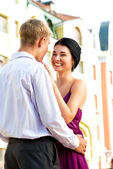 Young loughing couple on street — Stock Photo