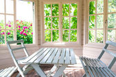 Summer house inside on sunny day — Stock Photo