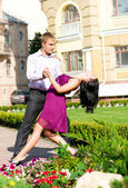 Young couple dancing on street — Foto de Stock