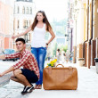 Young couple hitchhiking — Stock Photo #39254497