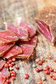 Slices of cured meet and pepper — Stock Photo