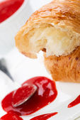 Croissant and strawberry jam close up — Stock Photo