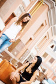 Girls with luggage — ストック写真