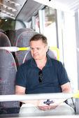 Man riding a bus — Stock Photo