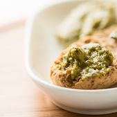 Toast with pesto sauce in bowl — Stock Photo