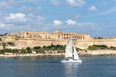 Sailboat over Valletta city — Stock Photo