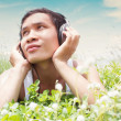 Man listening to music outdoor — Stock Photo