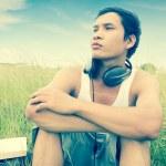 Man listening to music outdoor — Stock Photo