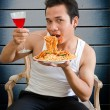 Man eating spaghetti with wine — Stock Photo #30958821