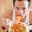 Man eating spaghetti — Stock Photo