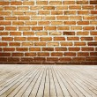 Wood Floor And Bricks Wall — Stock Photo