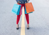 High Heels Girl With Shopping Bags Walking On Street — Stock Photo