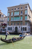 Tourists on a Gondola in Venice — Stock Photo