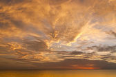 Dramatic sunset sky with clouds over ocean. — Stock Photo