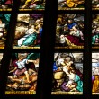 Biblical stories on stained glass in famous Duomo cathedral. Mil — Stock Photo
