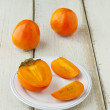 Ripe persimmon with cut — Stock Photo