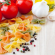 Ingredients for Italian cuisine: farfalle pasta, tomatoes, olive — Stock Photo #17202989