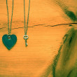 Foto de Stock  : Vintage Valentine, heart and key on rustic grunge cracked woo