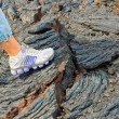Stock Photo: Foot on stones of volcanic flow
