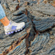Foot on the stones of volcanic flow — Foto Stock