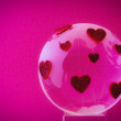 The planet of love. Glass globe with red hearts. — Stock Photo