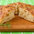 Homemade round Italian rosemary Focaccia bread sliced. — Stock Photo #18226271