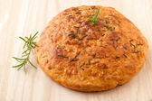 Homemade round Italian rosemary Focaccia bread. — Stockfoto