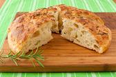 Homemade round Italian rosemary Focaccia bread sliced. — Stock Photo