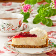 Tea time. Strawberry cheesecake and cup of tea. selective focus — Stock Photo