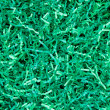 Close-up of green shredded paper packaging material background — 图库照片