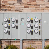 Electricity meters on a brick wall. — Stock Photo