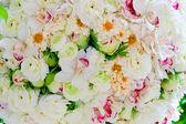 Silk flowers background — Stock Photo