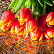 Red tulips  on mosaic table. — Stock Photo