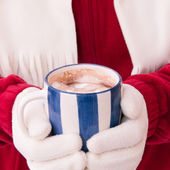 Woman in warm gloves holding cup of hot chocolate with marshmall — Foto de Stock