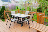 Patio of family home in early spring. — Stock Photo