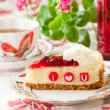 Stock Photo: Piece of strawberry cheesecake with edible letters for Valentine