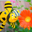 Stock Photo: Cheerful bee and flower.