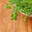 Thyme herb on wooden cutting board. — Stock Photo