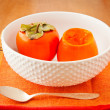 Stock Photo: Persimmons in bowl with spoon
